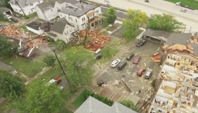 Roof debris scattered across street