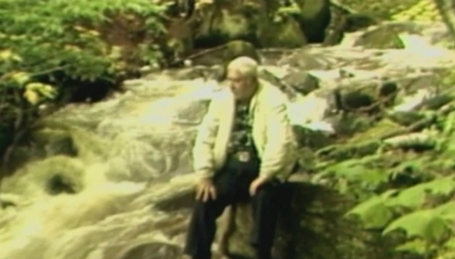 A photo of Dick Evans visiting the Hungarian Falls on the Keweenaw Peninsula in 1985.