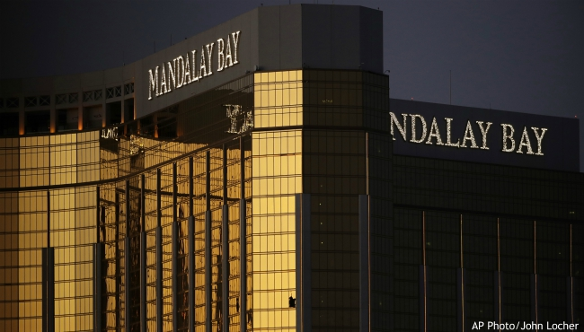 FILE - In this Oct. 3, 2017, file photo, windows are broken at the Mandalay Bay resort and casino in Las Vegas, the room from where Stephen Craig Paddock fired on a nearby music festival, killing 58 and injuring hundreds on Oct. 1. In the two years since the deadliest mass shooting in modern U.S. history, the federal government and states have taken some action to tighten gun regulations. But advocates say they're frustrated more hasn't been done since the attack in Las Vegas killed 58 people on Oct. 1, 2017, and that mass shootings keep happening across the country. (AP Photo/John Locher, File)