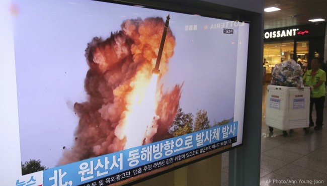 A TV screen shows a file image of a North Korea's missile launch during a news program at the Seoul Railway Station in Seoul, South Korea, Wednesday, Oct. 2, 2019. (AP Photo/Ahn Young-joon)