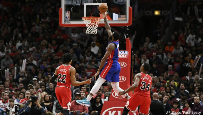 Detroit Pistons' Andre Drummond (0) goes up for a shot against Chicago Bulls' Wendell Carter Jr. (34) and Otto Porter Jr. (22) during the second half of an NBA basketball game Friday, Nov. 1, 2019, in Chicago. Chicago won 112-106. (AP Photo/Paul Beaty)