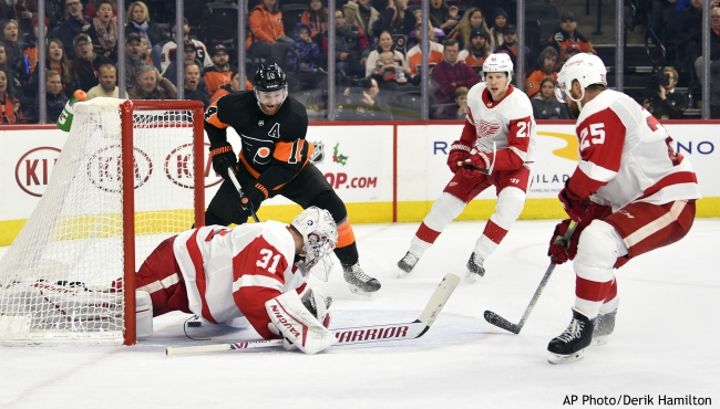 Philadelphia Flyers' Sean Couturier (14) scores a goal past Detroit Red Wings goaltender Calvin Pickard (31) during the second period of an NHL hockey game, Friday, Nov. 29, 2019, in Philadelphia. (AP Photo/Derik Hamilton)