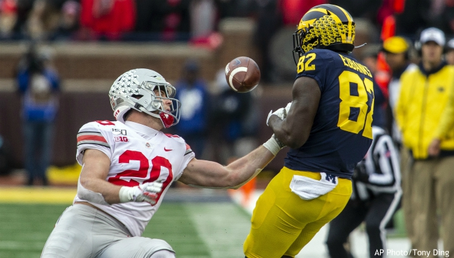 Ohio State linebacker Pete Werner (20) breaks up a pass intended for Michigan tight end Nick Eubanks (82) in the third quarter of an NCAA college football game in Ann Arbor, Mich., Saturday, Nov. 30, 2019. Ohio State won 56-27. (AP Photo/Tony Ding)