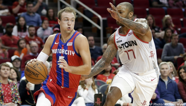 Detroit Pistons guard Luke Kennard (5) drives around Houston Rockets forward PJ Tucker (17) during the first half of an NBA basketball game Saturday, Dec. 14, 2019, in Houston. (AP Photo/Michael Wyke)