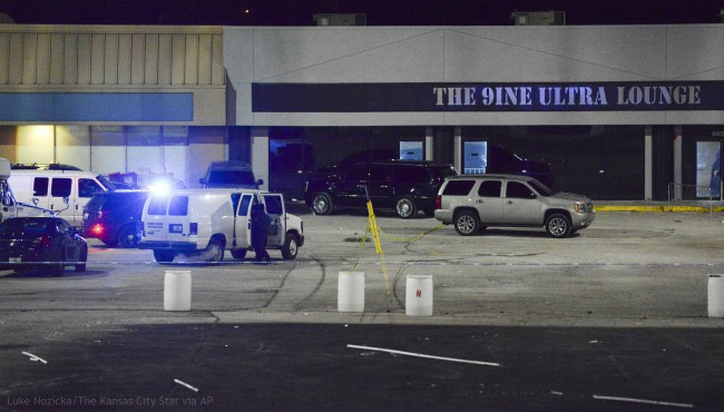 Kansas City, Mo., police crime scene investigators gather evidence at the scene of a shooting at a nightclub in the early hours of Monday, Jan. 20, 2020, in Kansas City, Mo. (Luke Nozicka/The Kansas City Star via AP)