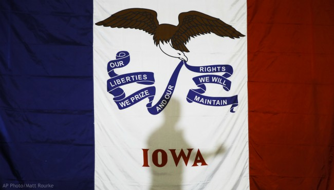 Democratic presidential candidate former South Bend, Ind., Mayor Pete Buttigieg's shadow is cast on the Iowas state flag as he speaks during a campaign event at Northwest Junior High, Sunday, Feb. 2, 2020, in Coralville, Iowa. (AP Photo/Matt Rourke)