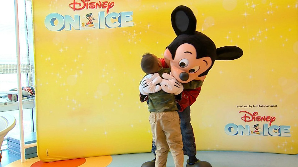 Mickey Mouse hugs a child at Helen DeVos Children's Hospital in Grand Rapids on Feb. 26, 2020.