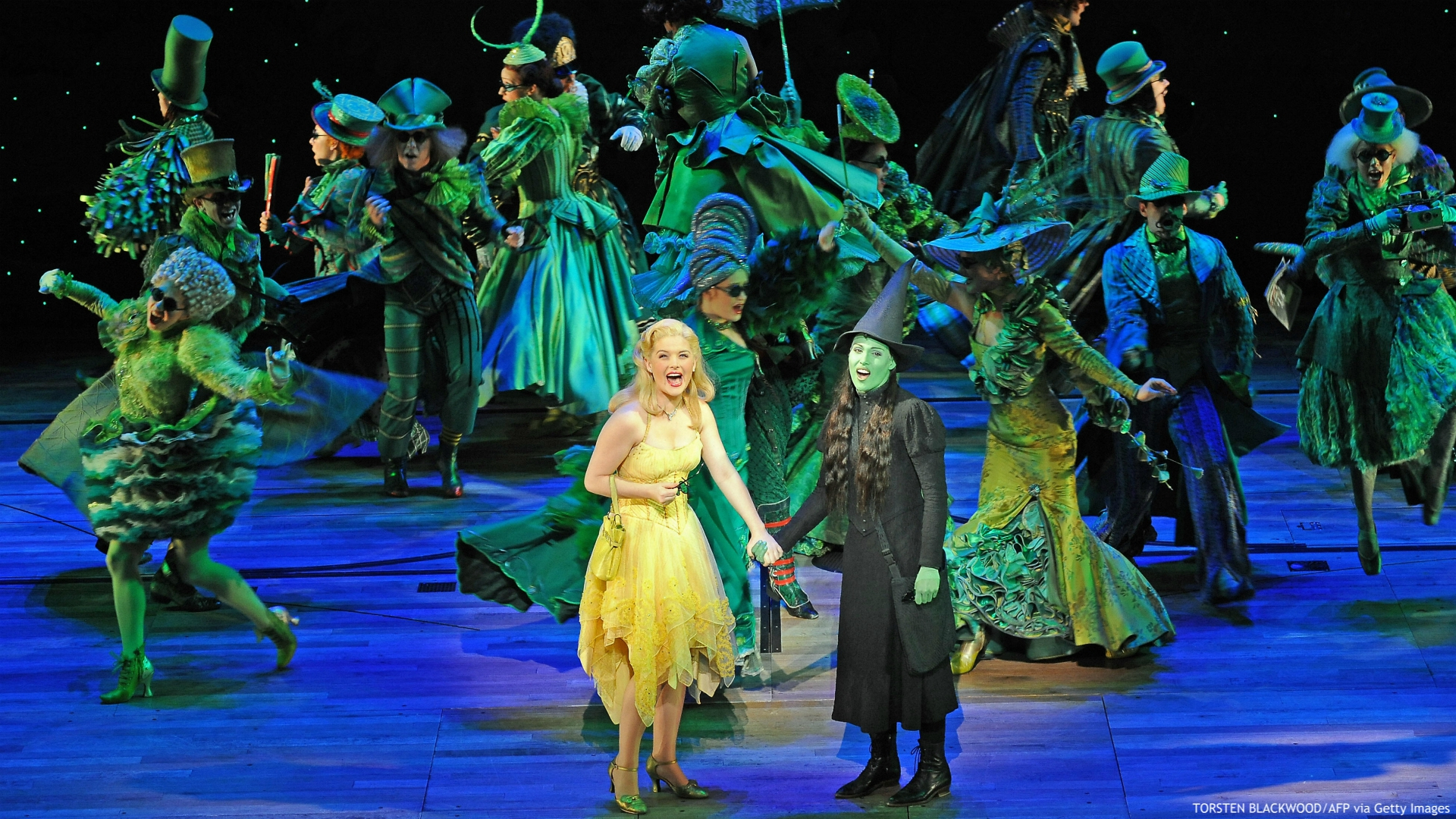 Glinda (C-L), played by Lucy Durack, and Elphaba (C-R), played by Amanda Harrison, perform in the highly acclaimed Broadway musical 'Wicked' during the preview in Sydney on September 10, 2009. 'Wicked', seen by over 20 million people worldwide, will open in Sydney on September 12. AFP PHOTO/Torsten BLACKWOOD (Photo credit should read TORSTEN BLACKWOOD/AFP via Getty Images)