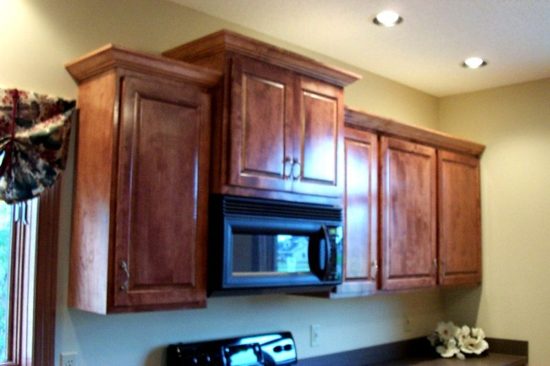 upper cabinets adjacent to a microwave
