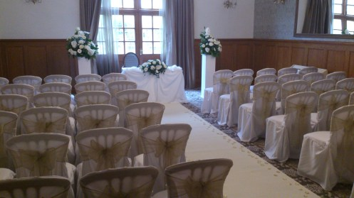Chair covers and flowers at Nunsmere Hall