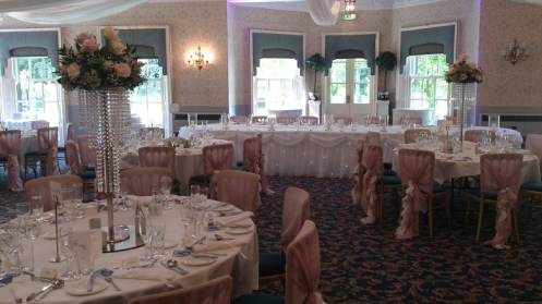 Dusky pink wedding venue dressing