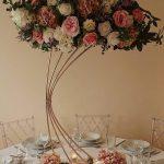 Gold harp floral wedding centrepiece