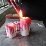Drip red wax over each white candle