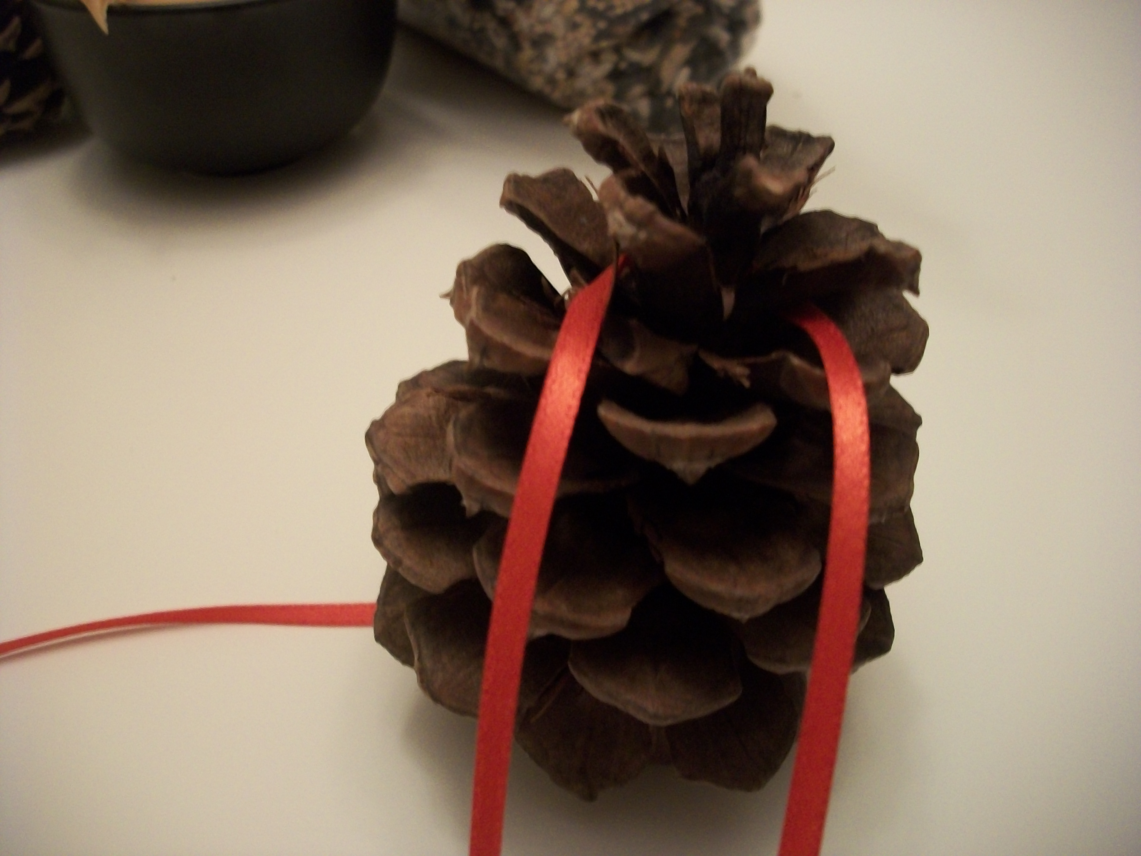 Move A Couple Of Layers From The Top Of The Pine Cone And