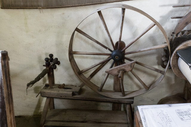 A very old spinning wheel