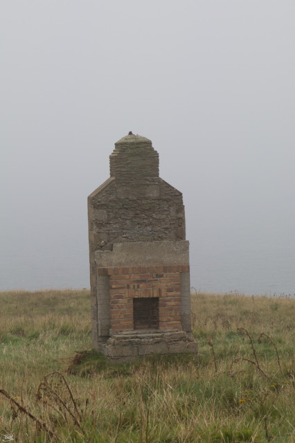 The sea, and the view, are behind the chimney