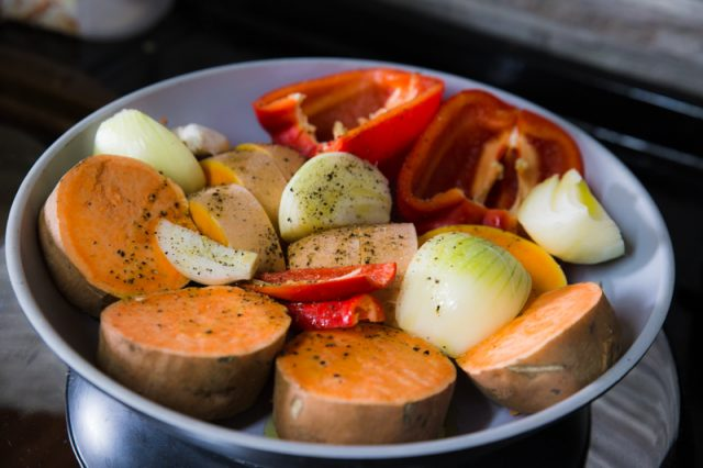 Orange Soup today: veg prepared fror roasting (butternut squash, sweet potato, red pepper, onion, garlic, chilli)