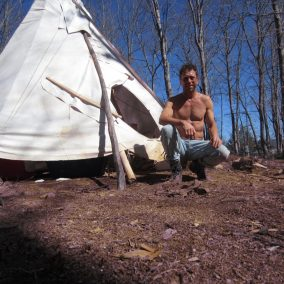 Patrick in front of Tipi