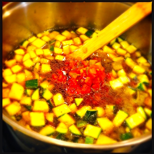Add tomatoes to pot