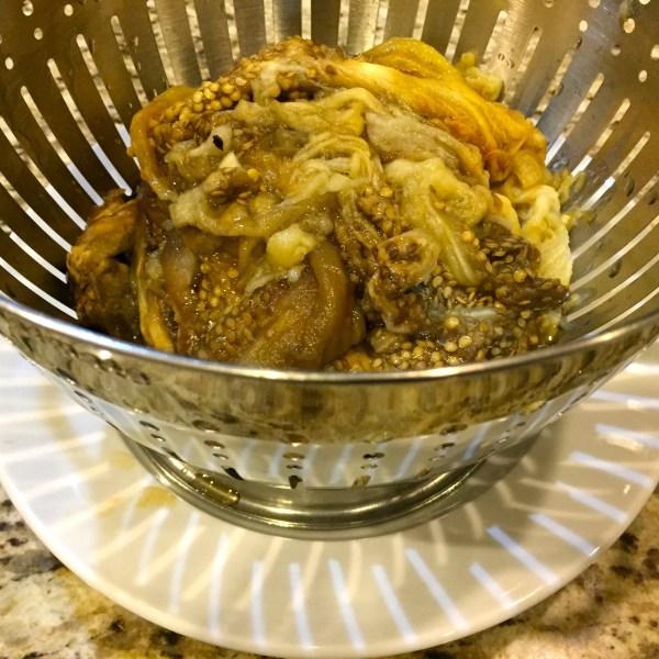 Eggplant in colander, draining