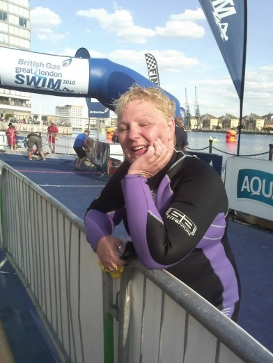 Tracey on the finishing line of The Great London Swim, Royal Victoria Dock, London.
