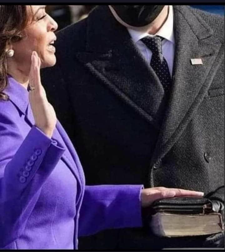 Kamala Harris taking oath.