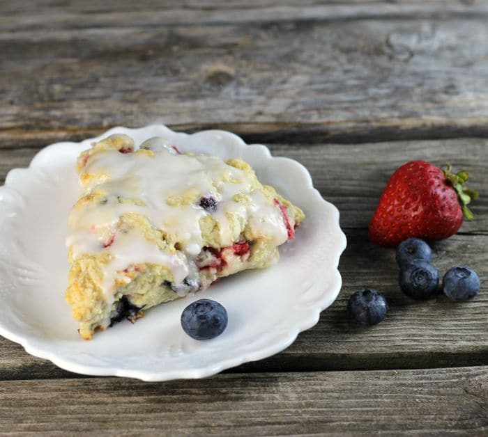 Mixed berry scones are filled with strawberries and blueberries a great way to start your morning off.