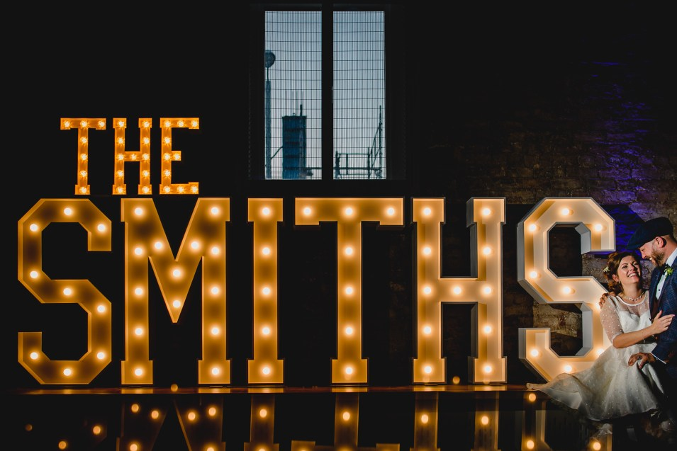 The SMITHS lighted wedding letters with bride and groom at The Halle in Manchester