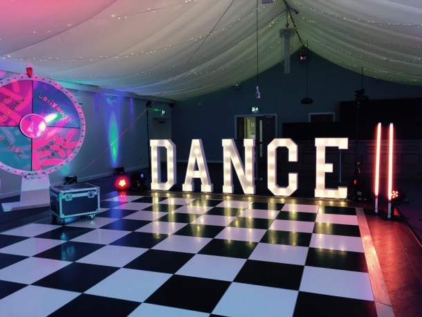 DANCE letter lights lighting up the marquee on CBBC's 'Marrying Mum and Dad'