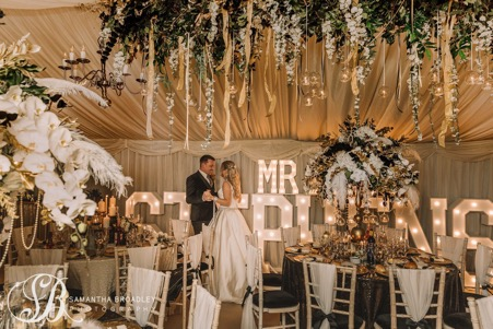 Mr & Mrs STEPHENSON light up letters in a marquee
