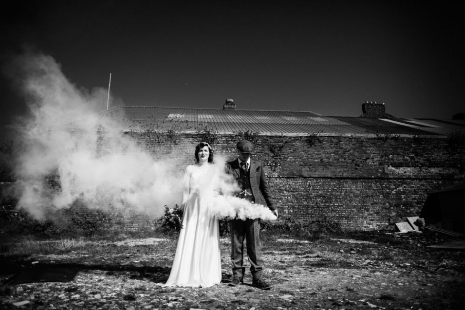 Bride and groom on open wasteland