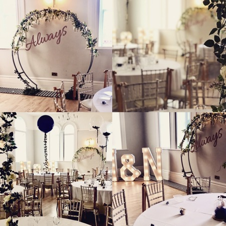 Circular Wedding and Ceremony Backdrop with wedding flowers and lighting