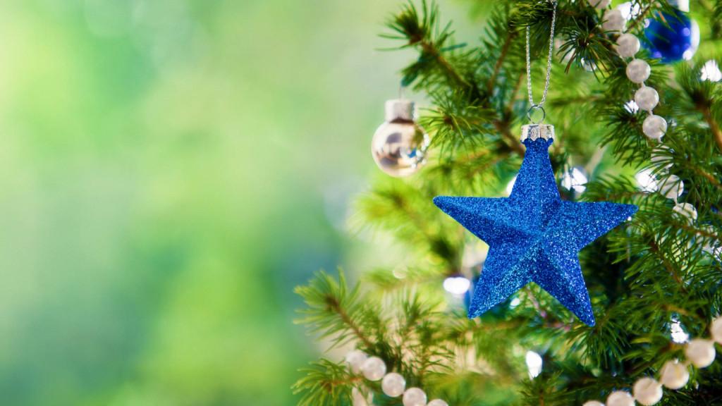Glittering blue Christmas star on Christmas tree