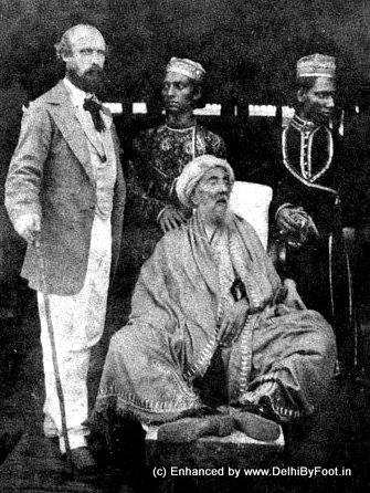 18. Mughal Emperor, Bahadur Shah Zafar posing with Thomas Metcalfe and two attendants.