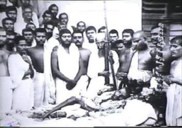 25. Rare photograph of the Last Rites of Ramakrishna Paramahamsa with a young Vivekananda in mourning, 1886.
