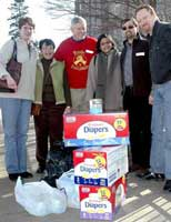 A delegation from<br>Women's Fightback Network<br>and International Action<br>Center bring supplies for<br>immigrant families.