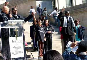 Megan Williams, victim of racist torture<br>and abuse, stands strong at rally between<br>Malik Shabazz of Black Lawyers for Justice<br>and her mother, Carmen Williams.