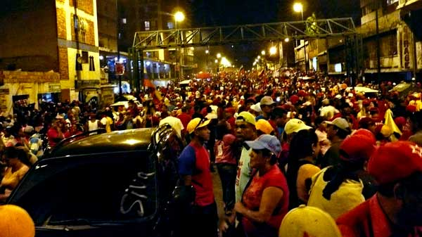 "On Feb. 15, Venezuelans lined up at the polls to vote ""si"" or ""no"" on term limits for elected officials including President Hugo Chávez, and the people have spoken. Nearly 55 percent of the voters decided in favor of having indefinite term limits. The struggle amongst the Venezuelan people for a socialist revolution has far from died as the media would have you believe. This vote, as said President Chávez, ""was a vote for socialism."" Above, thousands of people celebrate in the Venezuelan capital of Caracas following the vote."
