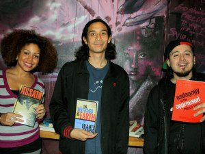 Rebel Diaz Arts Collective members Claudia De la Cruz and Rodrigo Venegas (right) joined with Sky Cohen (center), from the bookstore Bluestockings, to create a new library.