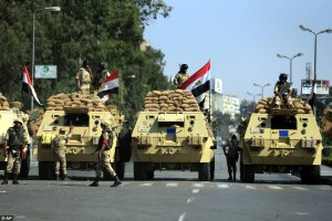 Egyptian Army guards road near Presidential Palace, one day after July 3 coup.