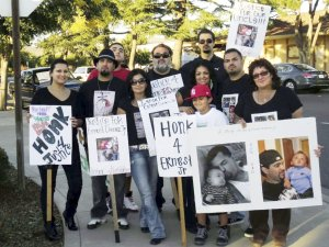 Rosemary Duenez , far right, holds photo of her son, Ernest Duenez Jr, killed by police.WW photo: Dante Strobino