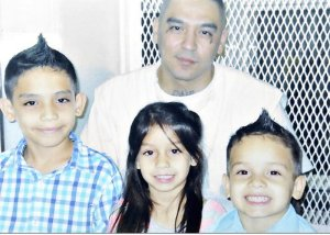 Robert Garza on death row with his three children. He was executed Sept. 19.