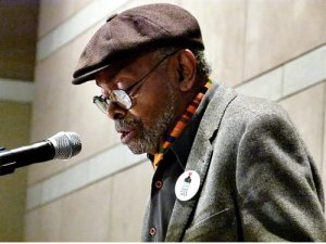 "Baraka reads ""Somebody Blew Up America"" poem before 1,100 people at Mumia Abu-Jamal solidarity rally at the Philadelphia Constitution Center in Philadelphia, Pa., on Dec. 9, 2011.WW photo: Joseph Piette"