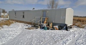 The Fort Yates, North Dakota, mobile home where Debbie Dogskin was found dead of exposure to extreme cold. The temperature inside was -1 degree Fahrenheit and the propane tank was empty.