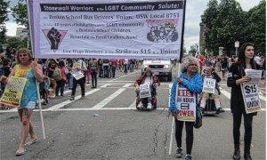 LGBTQ activists honor Boston school bus drivers union in Pride March.WW photo: Stevan Kirschbaum