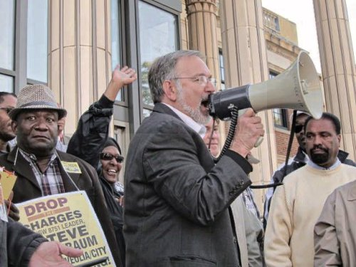 Andre Francois, left, and Steve Kirschbaum (with bullhorn) at Sept. 15 rally. Both were illegally fired by Veolia.Photo: Howard Rotman