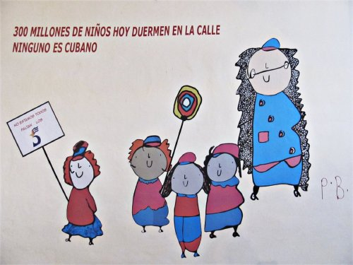 This mural on the wall of ExpoHolguin in Holguin, Cuba, was painted by Spanish artist Paco Bernal Gil. It reads, '300 million children sleep in the street today; not one of them is Cuban.'