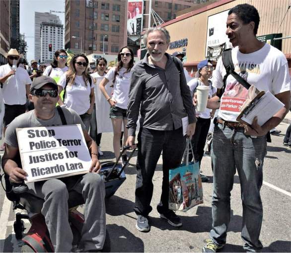 John Parker, on right, at May Day rally in Los Angeles.