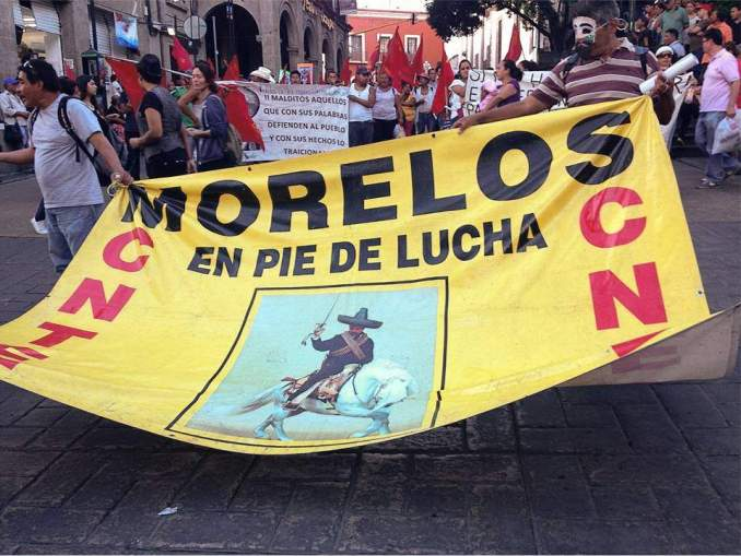 Supporters of embattled teachers' union CNTE march in Morelos.