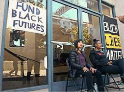 Anti Police-Terror Project activists chain themselves to the Oakland Police Association headquarters.
